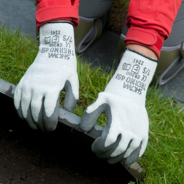 persons hands wearing grey SHOWA 451 gloves pulling up a flag