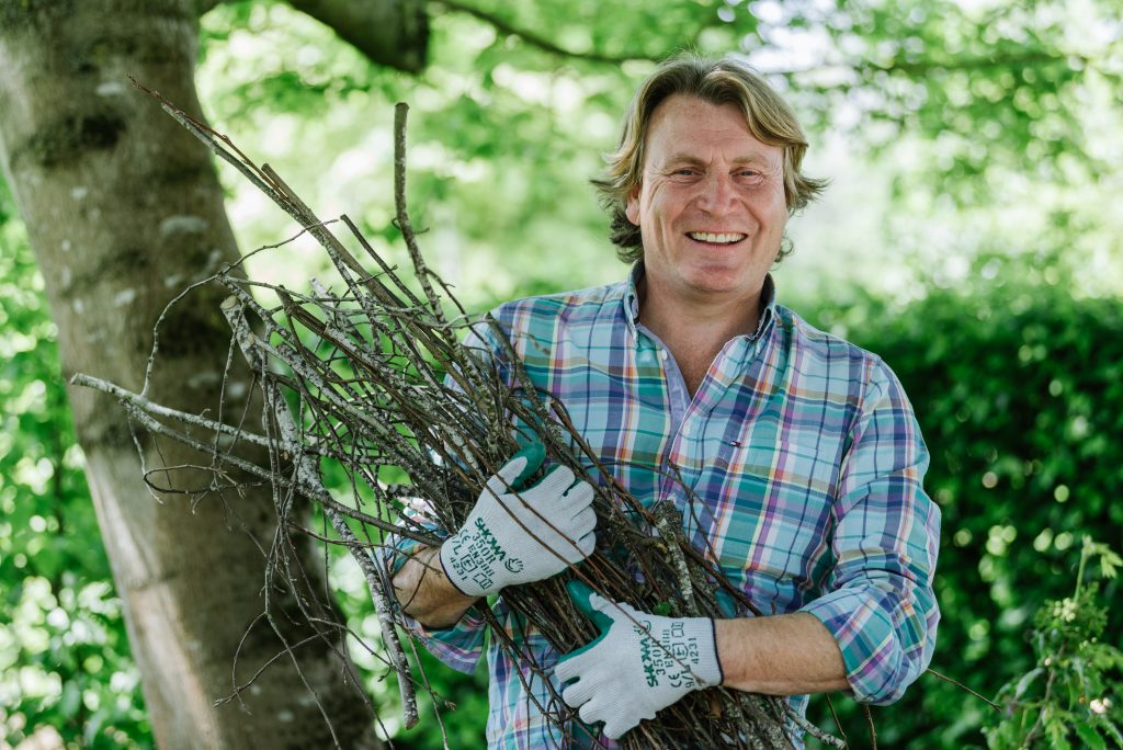 David Domoney holding a bunch of twigs while wearing SHOWA 350R Thornmaster gloves